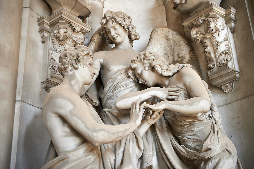 Picture and image  of the stone sculpture  of a young couple and an angel. The Pietrafraccia Tomb sculped by G. Navone 1909. Section A, no 17, The monumental tombs of the Staglieno Monumental Cemetery, Genoa, Italy .<br /> <br /> Visit our ITALY PHOTO COLLECTION for more   photos of Italy to download or buy as prints https://funkystock.photoshelter.com/gallery-collection/2b-Pictures-Images-of-Italy-Photos-of-Italian-Historic-Landmark-Sites/C0000qxA2zGFjd_k<br /> If you prefer to buy from our ALAMY PHOTO LIBRARY  Collection visit : https://www.alamy.com/portfolio/paul-williams-funkystock/camposanto-di-staglieno-cemetery-genoa.html