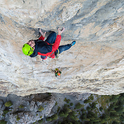 Sonnie Trotter leading his new variation to Blue Jeans, Blue Jeans Direct, 5.14a. Blue Jeans is an 8 pitch route on Mt Yamnuska in Alberta, Canada
