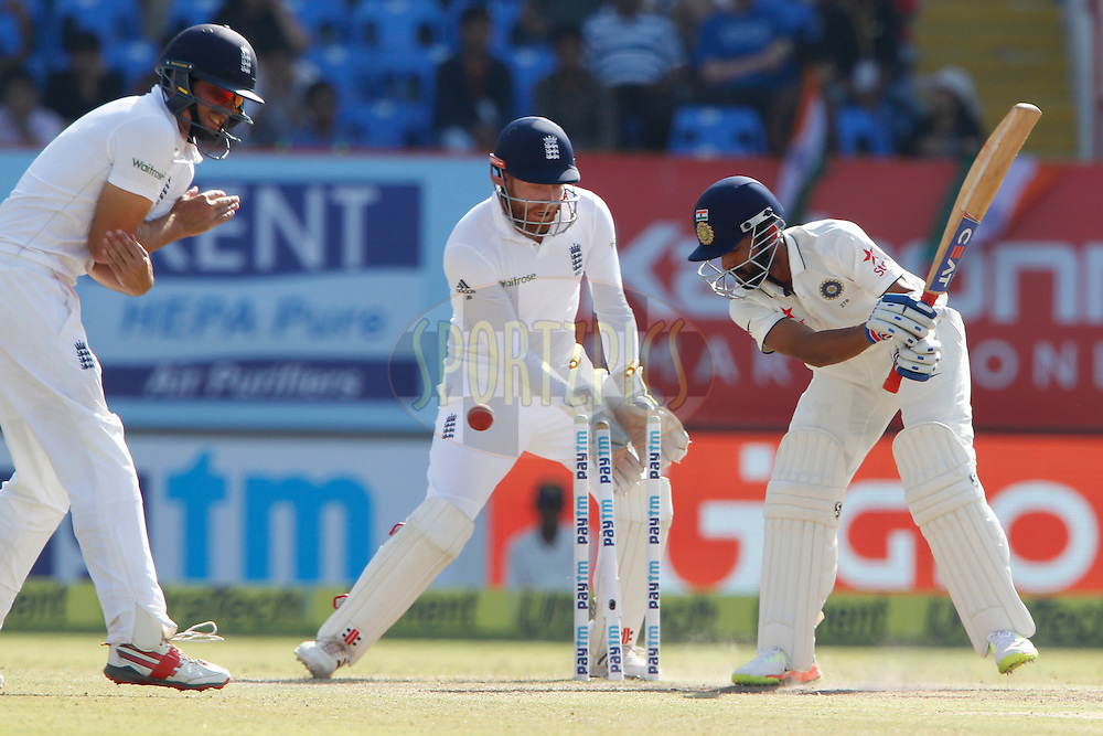 Ajinkya Rahane of India is bowled by Moeen Ali of England during day 5 of the first test match between India and England held at the Saurashtra Cricket Association Stadium , Rajkot on the 13th November 2016.<br /> <br /> Photo by: Deepak Malik/ BCCI/ SPORTZPICS