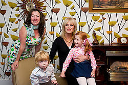 © Licensed to London News Pictures. 27/09/2012. LONDON, UK. Actress Joanna Lumley sits in a recreated 70's sitting room with a family dressed in period clothing at the launch of YouView in London today (27/09/12). YouView, launched today by broad band provider TalkTalk, provides on demand television for its customers who will be given the set-top boxes for free. Photo credit: Matt Cetti-Roberts/LNP