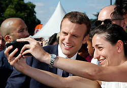 French President Emmanuel Macron (L) poses for a selfie during a visit to a site on the Pont Alexandre III in Paris, France, June 24, 2017. The French capital is transformed into a giant Olympic park to celebrate International Olympic Days with a variety of sporting events for the public across the city during two days as the city bids to host the 2024 Olympic and Paralympic Games. Photo by Jean-Paul Pelissier/Pool/ABACAPRESS.COM