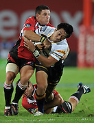 Brumbies Flyhalf, Christian Lealiifano is tackled by Louis Ludik and Andre Pretorius in the Super 14 match between the Lions and the Brumbies that took place on Saturday 21 March 2009 at Coca-Cola Park in Johannesburg South Africa. The Lions won this Super 14 match against the Brumbies 25 - 17.  <br /> Photographer : Anton de Villiers / SASPA