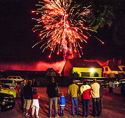Villagers watching a firework display during Bastille day celebrations in the village of Neuwiller-les-Saverne, Alsace France.<br /> <br /> (c) Andrew Wilson | Edinburgh Elite media