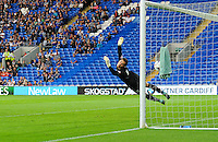 GOAL - AFC Wimbledon's James Shea is beaten by Cardiff City's Craig Noone free kick to put Cardiff City into the lead<br /> <br /> Photographer Craig Thomas/CameraSport<br /> <br /> Football - Capital One Cup First Round - Cardiff City v AFC Wimbledon - Tuesday 11th August 2015 - Cardiff City Stadium - Cardiff <br /> © CameraSport - 43 Linden Ave. Countesthorpe. Leicester. England. LE8 5PG - Tel: +44 (0) 116 277 4147 - admin@camerasport.com - www.camerasport.com