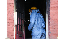 © Licensed to London News Pictures. 10/02/2020. London, UK. A forensic officer inside a property on Olinda Road, in Hackney, North London following a fire where a woman died. Police were called to Olinda Road at around midnight. According to the neighbours, the woman was in her 70s. Photo credit: Dinendra Haria/LNP