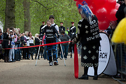 © licensed to London News Pictures. London, UK 08/05/2012. Claire Lomas, who paralysed from the chest down after an accident, finishing the London Marathon today after 16 days with a robotic suit to raise money for Spinal Research (08/05/12). Photo credit: Tolga Akmen/LNP