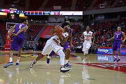 29 December 2016:  Keyshawn Evans(3) turns inward to storm the hoop during an NCAA  MVC (Missouri Valley conference) mens basketball game between the Evansville Purple Aces the Illinois State Redbirds in  Redbird Arena, Normal IL