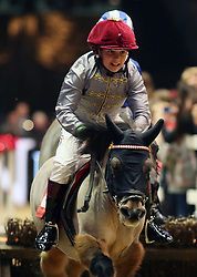 Rocco Dettori wins the Osborne refrigerators shetland Pony Grand National during day four of the London International Horse Show at London Olympia.
