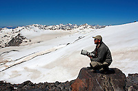Russia, Caucasus. Photographer Tom Schandy on mission on Mount Elbrus.