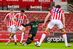 Lucas of Tottenham Hotspur goes down in the box, under a challenge from Danny Batth of Stoke City  - Mandatory by-line: Nick Browning/JMP - 23/12/2020 - FOOTBALL - Bet365 Stadium - Stoke-on-Trent, England - Stoke City v Tottenham Hotspur - Carabao Cup