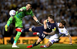 Leeds United goalkeeper Kiko Casilla (left) attempts to collect the ball from Derby County's Jack Marriott and Leeds United's Gaetano Berardi during the Sky Bet Championship Play-Off, Semi Final, Second Leg match at Elland Road, Leeds.
