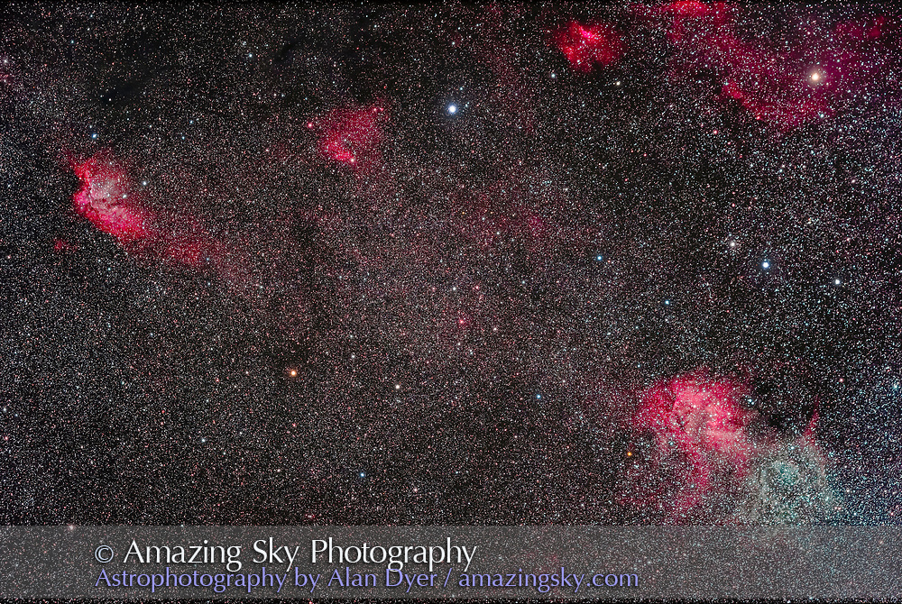 """The area in Cepheus containing NGC 7380 (upper left), aka the Wizard Nebula, as well as the famous double and variable star Delta Cephei, at top centre. The star at upper right is Zeta Cephei. The brighter nebula between the two stars is Sharpless 2-136. The large nebula at lower right, containing both red hydrogen-alpha and green oxygen-III emission regions, is Sharpless 2-132. The field of view here is 6° by 4°. <br /> <br /> This is a blend of a stack of 8 x 12-minutes at ISO 1600 through an IDAS NB1 narrowband filter, with a stack of 14 x 6-minute exposures at ISO 800 with a """"clear"""" Astronomik UV-IR Cut filter, all with the Canon EOS Ra camera through the SharpStar 76mm apo refractor at f/4.4 with its field flattener/reducer. Autoguided and dithered with the MGEN3 auto-guider. No darks or LENR employed. Faint nebulosity brought out with the aid of luminosity masks created with Lumenzia."""