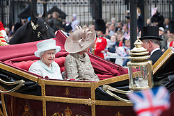 © Licensed to London News Pictures. 05/06/2012. London, UK. The Royal Jubilee celebrations. The Queen, Duke and Duchess of Cornwall riding along Whitehall as Great Britain is celebrating the 60th anniversary of the countries Monarch HRH Queen Elizabeth II accession to the throne this weekend. Photo credit : Tolga Akmen/LNP