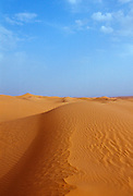 Blue sky and sand dunes in the Sahara Desert, Morocco