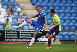 Luke Norris of Colchester United controls the ball under pressure - Mandatory by-line: Arron Gent/JMP - 18/06/2020 - FOOTBALL - JobServe Community Stadium - Colchester, England - Colchester United v Exeter City - Sky Bet League Two Play-off 1st Leg