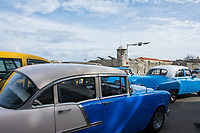 Havana, Cuba - American cars on the Malecón road facing Havana Bay. Classic American cars from the 1950s, imported before the U.S. embargo, are commonly used as taxis in Havana.