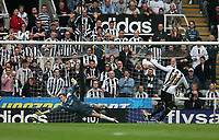 Photo: Andrew Unwin.<br />Newcastle United v West Bromwich Albion. The Barclays Premiership. 22/04/2006.<br />Newcastle's Shola Ameobi (R) beats West Bromwich's Tomasz Kuszczak from the penalty spot to score his team's second goal.