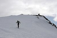 Mann på topptur, fjellski med skifeller, man on hiis way to the top of a mountain, Gråsteinutan (1306 m)