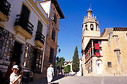 Elderly British tour group explore the historic old town by the cathedral in Ronda, Andalucia, Spain