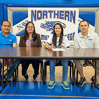 060613       Brian Leddy<br /> Krishia Artieda, in white shirt, is surrounded by her parents Henry and Nelia as well as Northern New Mexico College women's basketball coach Jack Ballard.  Artieda, who played for Navajo Pine, signed a letter of intent to play basketball with the school.