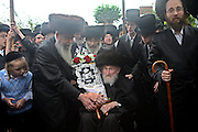 When a new Sefer Torah (five books of Moses) is completed after years of work it is carried in a big community parade to synagogue. Rabbi's and leaders young and old from the Ashkenazi Nitra group take it turns to carry the decorated scrolls to their Shul on Clapton Common, Stamford Hill.  Throughout the procession a cloth roof is held over the person carrying the scrolls.