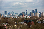 Landscape view of the city of London skyline with iconic modern architectural buildings including Canary Wharf, HSBC and The Gherkin taken from Primrose Hill, London, England, United Kingdom.