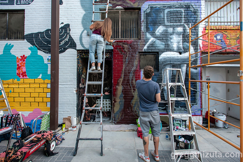 """Connor Marquette. Freak Alley Gallery eighth annual mural event in downtown Boise, Idaho on August 11, 2018. <br /> <br /> Freak Alley Gallery's week long event provided an """"art-in-motion"""" experience as it welcomed the public to watch artists work on their murals."""