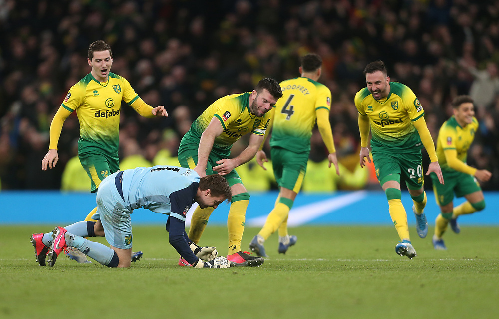 Norwich City's Tim Krul and Grant Hanley lead the celebrations after winning the penalty shoot-out <br /> <br /> Photographer Rob Newell/CameraSport<br /> <br /> The Emirates FA Cup Fifth Round - Tottenham Hotspur v Norwich City - Wednesday 4th March 2020 - Tottenham Hotspur Stadium - London<br />  <br /> World Copyright © 2020 CameraSport. All rights reserved. 43 Linden Ave. Countesthorpe. Leicester. England. LE8 5PG - Tel: +44 (0) 116 277 4147 - admin@camerasport.com - www.camerasport.com