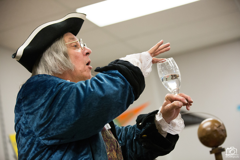 Ben Franklin (played by Phil Soinski) demonstrates making music from glasses to students during the International Printing Museum's Ben Franklin's Colonial Assembly: A Museum On Wheels at Curtner Elementary School in Milpitas, California, on May 13, 2014. (Stan Olszewski/SOSKIphoto)