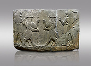 Hittite relief sculpted orthostat stone panel of Herald's Wall. Basalt, Karkamıs, (Kargamıs), Carchemish (Karkemish), 900-700 B.C. Anatolian Civilisations Museum, Ankara, Turkey.<br /> <br /> Protective mixed creatures. One each hand of the lion-headed men is in the form of a fist. The mace on the left is over the head of the weapon on the right. The two bull-men in the middle carry one spear each in their hands. Bull-man is known as Kusarikku, and the lion-man is known as Ugallu. .<br />  <br /> If you prefer to buy from our ALAMY STOCK LIBRARY page at https://www.alamy.com/portfolio/paul-williams-funkystock/hittite-art-antiquities.html  - Type  Karkamıs in LOWER SEARCH WITHIN GALLERY box. Refine search by adding background colour, place, museum etc.<br /> <br /> Visit our HITTITE PHOTO COLLECTIONS for more photos to download or buy as wall art prints https://funkystock.photoshelter.com/gallery-collection/The-Hittites-Art-Artefacts-Antiquities-Historic-Sites-Pictures-Images-of/C0000NUBSMhSc3Oo