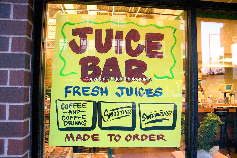 Juice Bar poster in the window of the Mississippi Market a natural foods co-op located at Dale and Selby in the regentrified inner city area.  St Paul Minnesota USA