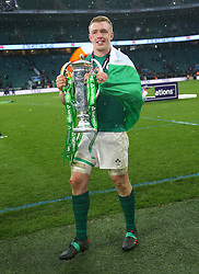Ireland's Dan Leavy celebrates with the trophy after winning the grand slam during the NatWest 6 Nations match at Twickenham Stadium, London.