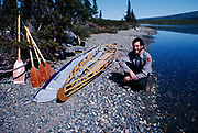 Self Portrait of Backcountry Park Ranger Fred Hirschmann on beach of Lower Twin Lake after assembling frame of Klepper kayak, Lake Clark National Park, Alaska.
