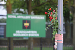 © Licensed to London News Pictures. 22/05/2013.Woolwich 'terrorist attack': One dead and two seriously injured. Woolwich Barracks,Woolwich..First flowers outside Woolwich barracks tonight 22.05.2013..Photo credit :Grant Falvey/LNP