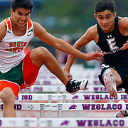 Harlingen South's Joey Torres has trouble clearing a hurdle as Weslaco East's J.R. Villarreal chases him during the Boys 110 Meter Hurdles in the finals of the Weslaco Mid-Valley Classic at Bobby Lackey Stadium in Weslaco. Villarreal pulled in front of the Torres to beat him in the event. <br /> Nathan Lambrecht/The Monitor