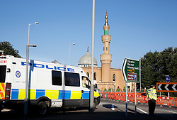 © Licensed to London News Pictures. 19/07/2013. Wolverhampton, West Midlands, UK. Police attending the Central Mosque in Wolverhampton after the Mosque was closed due to a believed bomb incident. Photo credit : Dave Warren/LNP