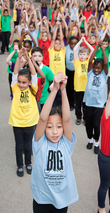 © Licensed to London News Pictures. 18/05/2012. London, England. Ca. 730 London schoolchildren from the Burdett Coutts Primary School in Victoria, today, Friday 18th May, joined over half a million children in 53 countries for the Big Dance World Record Attempt (Guinness Book of Records). During the dance the children depicted Olympic sports disciplines. Photos taken during rehearsal. Photo credit: Bettina Strenske/LNP