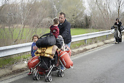 March 1, 2016 - Athens, Greece - <br /> <br /> A family walks the highway. Thousands of migrants are stuck at the border between Greece and Macedonia where only the Syrians and the Iraqis can pass. Tthe border remains closed causing mass crowding, some 10,000 people are at the border living in desperate conditions. <br /> ©Exclusivepix Media