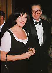LORD & LADY SAATCHI at a party in London on 22nd February 1999. MON 184