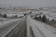 snow on a road in winter on causse sauveterre  in Cevennes. landscape
