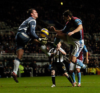 Photo: Jed Wee.<br /> Newcastle United v Aston Villa. The Barclays Premiership. 31/01/2007.<br /> <br /> Newcastle goalkeeper Steve Harper (L) jumps to deny Aston Villa's Gareth Barry.