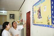Sabin Institute senior program officer Karen Palacio, (left) listens to a health worker tell her about deworming activities at the health center in San Esteban, Honduras on Thursday April 25, 2013.