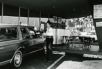 1976 Car hop delivers food at Tiny Naylor's Drive In at Sunset Blvd. & La Brea Ave.
