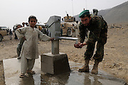 """An ANA soldier from 3rd Brigade, 201st Corps, drinks water from a new well during an operation in Tagab Valley.....Colonel Haynes said the battle plan, """"The creeping barrage of goodness,"""" to win the hearts and minds of the Tagab Valley includes: a paved road, wells, radio stations, solar power, humanitarian aid, and medical outreach.  Agricultural development teaching how to package goods, and pruning techniques to increase crop yields.  Saffron cultivation started too, as a replacement to poppy.  More projects like schools and police checkpoints will follow as resources allow..."""