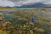 Luke Nelson and Krissy Moehl on the long, cold and awesome ford of the Radujavri lake/river while trail running the Kings Trail in artic Sweden. This is day 6 of the run, between Alesjoure and Abiskojaure huts.