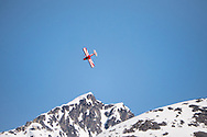 Scott Sexton performing his aerobatic routine at the Valdez fly-in & Air Show in Valdez, Alaska. May 10 and 11, 2014. Photo by Scott Dickerson.