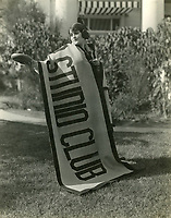1922 Lois Lee holds the Hollywood Studio Club's banner