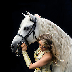 """Portrait of Tatiana Tchalabaeva, who is an acrobat with the Thundering Cossack Warriors. """"It's a lot of fun, [but there is] a lot of danger to it. Anything can happen. Horses can fall, you can fall, anything can happen. But you just go out there and you enjoy it, it's fun. It's an amazing feeling, the bond between animal and you. We love it. Our horses are just like our kids, we love them. They're part of our family.""""<br /> <br /> After 146 years, the """"Greatest Show on Earth"""" will close its curtain in the end of May. <br /> Ringling Bros. and Barnum & Bailey Circus started in 1919 when the circus created by James Anthony Bailey and P. T. Barnum merged with the Ringling Brothers Circus. The circus' parent company, Feld Entertainment, made the decision to end the show after waning ticket sales and long court battles over the treatment of animals, particularly the elephants, made the costly entertainment event unsustainable."""