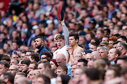 An Aston Villa supporter looks on nervously as his friend holds up Aston Villa shoe - Photo mandatory by-line: Rogan Thomson/JMP - 07966 386802 - 19/04/2015 - SPORT - FOOTBALL - London, England - Wembley Stadium - Aston Villa v Liverpool - FA Cup Semi Final.