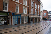 Empty tram lines leading down from the Town Hall to Grand Central in Birmingham city centre, which is virtually deserted under Coronavirus lockdown on a wet rainy afternoon on 28th April 2020 in Birmingham, England, United Kingdom. Britains second city has been in a state of redevelopment for some years now, but with many outdated architectural remnants still remaining, on a grey day, the urban landscape appears as if frozen in time. Coronavirus or Covid-19 is a new respiratory illness that has not previously been seen in humans. While much or Europe has been placed into lockdown, the UK government has put in place more stringent rules as part of their long term strategy, and in particular social distancing.